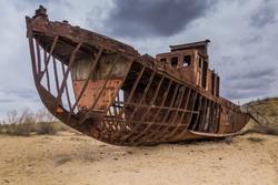 Rusting ship at the Ship Cemetery near Moynaq village at the former coast of Aral Sea, Uzbekistan