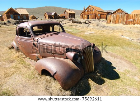 rusty, abandoned car in Bodie ghost town - stock photo