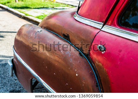 Rusty american classic car parked on the street. stock photo