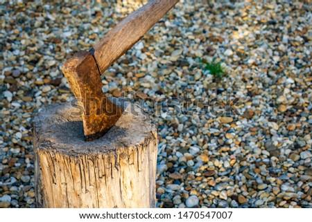 Rusty axe in a wooden chopping block Stock fotó ©