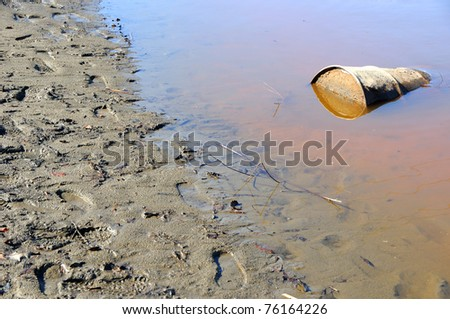 Rusty Barrel Pollutes River