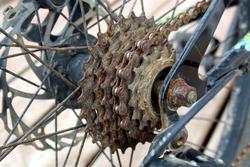 rusty bike sprocket parts on the rear wheel