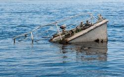 Rusty boat wreck in a blue river