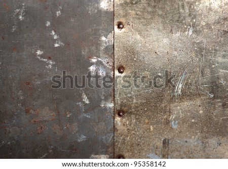 Rusty bolts on grunge metal background
