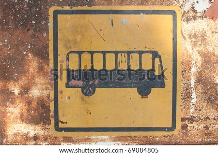 Rusty bus stop sign