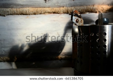Rusty can opener in a metal pot  #665386705