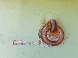 Rusty cast iron ring attached to a wall at Battery Mendell, Fort Barry, Marin County, California, USA.