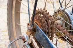 RUSTY CHAIN-WHEEL OF OLD BICYCLE