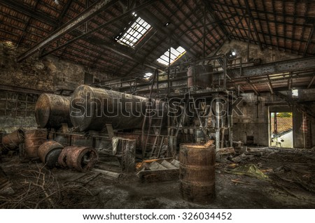 Stock Photo Rusty cisterns and barrels in an abandoned factory, HDR processing
