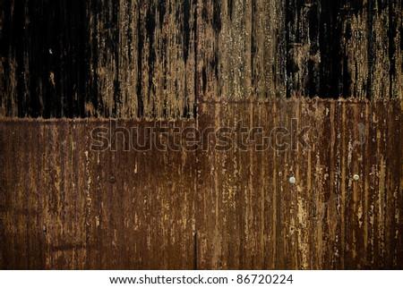 rusty corrugated fence.