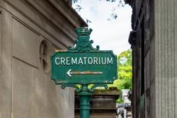 Rusty Crematorium sign in Pere Lachaise Cemetery - Paris, France.