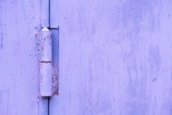 Rusty door hinge painted with fresh paint over rust, changed color