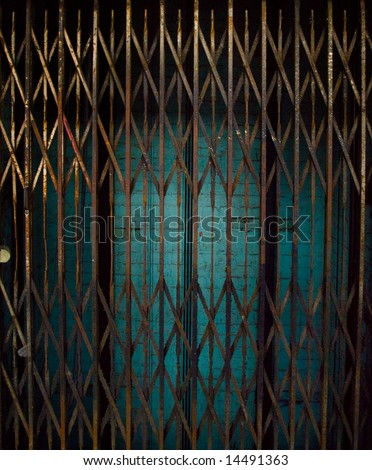 Rusty Elevator Gates and Dark Lift Shaft