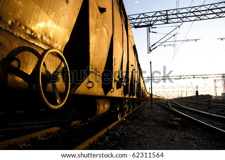Rusty Freight trains on sunrise with golden reflection