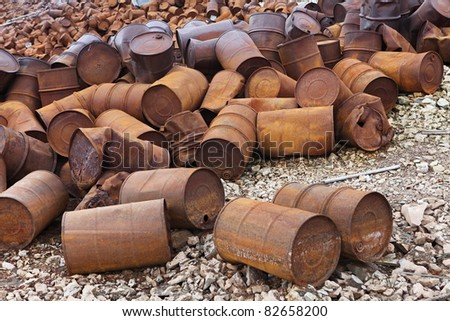 Rusty fuel and chemical drums on Arctic coast