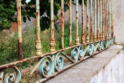 Rusty garden fence with ornaments
