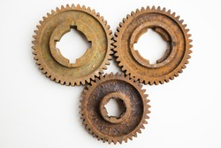 Rusty gears from an old mechanism on a white background, photographed up close.