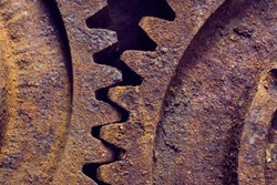 Rusty gears from old mechanism photographed at close range.