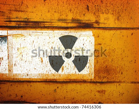 rusty grunge metal industrial background with radiation symbol