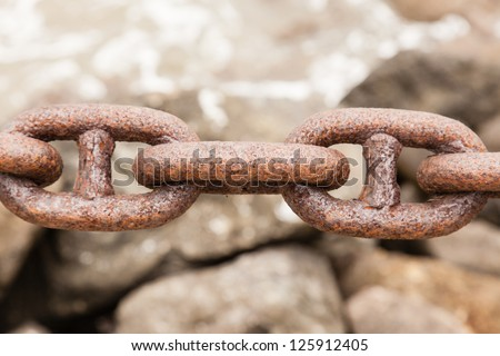 Rusty heavy chain in a port.