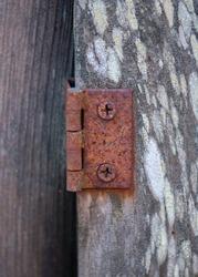 Rusty Hinge on weathered wood