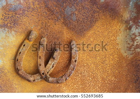rusty horseshoes on a red iron...
