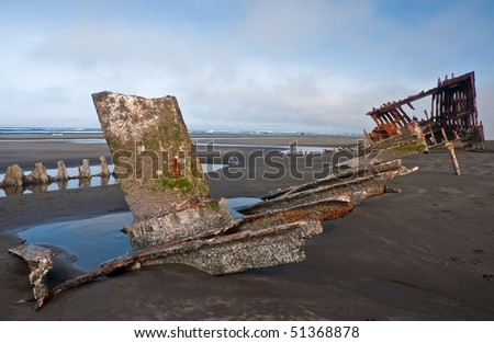 rusty hull of the Peter Iredale shipwreck