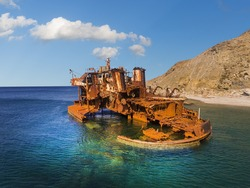 Rusty iron wreck of a ship on the coast of the Greek island of Limnos in the North Aegean