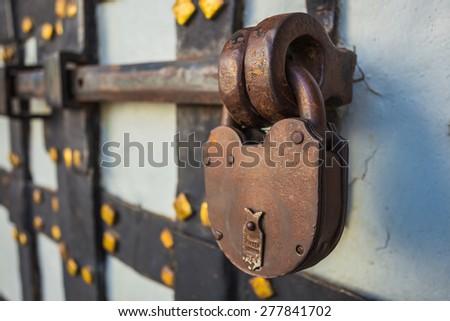 rusty lock with deadbolt on the old door