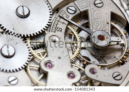 Stock Photo rusty mechanism in the old clock