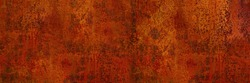 Rusty metal background. Rust texture. Orange red brown abstract background. Bright rough textured background. Wide banner.