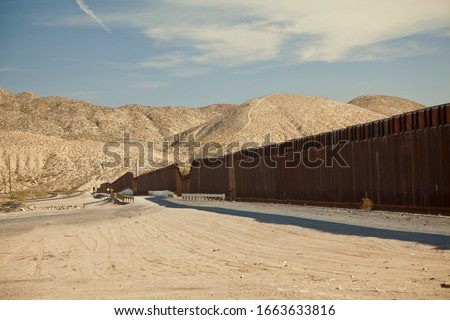 Rusty, metal Border Fence_Wall between United States and Mexico in the U.S. State of New Mexico and Ciudad Juarez, in the Mexican State of Chihuahua.