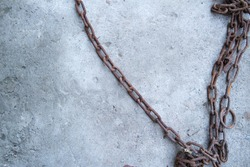rusty metal chain on concrete background.