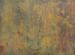 rusty metal discolored surface with yellow, green and gray natural tones - worn background with scratches and lichens for a wallpaper