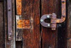 Rusty metal hinge, old gate