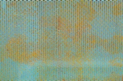 Rusty metal mesh texture. Copy space. Blue color.