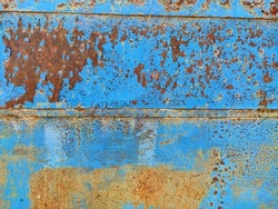 Rusty metal panel with cracked blue paint, corroded grunge metal background texture
