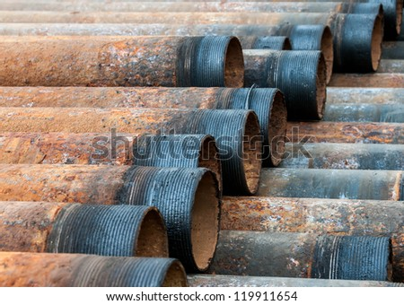 Rusty metal pipe with threads visible