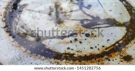 Rusty metal. Rusty iron Rusted bucket. Water and rust. #1451282756