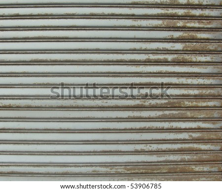 rusty metal store roller shutter