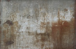 rusty metal surface with gray and light brown tones - worn steampunk background with scratches and grooves