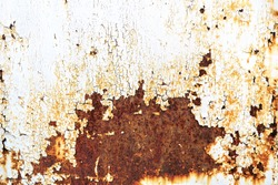 Rusty metal texture background with cracked white paint