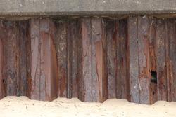 Rusty metal texture of iron coastal defences on a beach