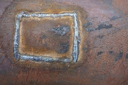 Rusty metal. texture of pipe background with a weld seam. Metal red corrosion. Orange gentle structure of oxidation on welded seam.