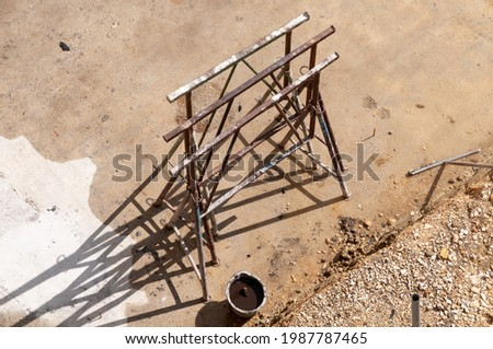 rusty metal trestles standing on a wet floor at a construction site Stockfoto ©