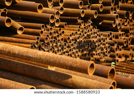 Rusty metal tubes industrial background. Rusty steel texture. Rusty tubes at construction site