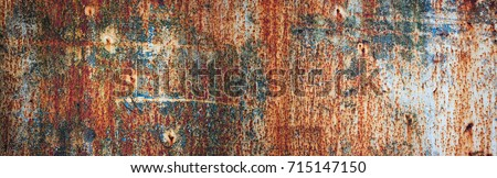 Rusty metal wall, old sheet of iron covered with rust with multi-colored paint ストックフォト ©