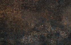 Rusty metal with a lot of black stains background.