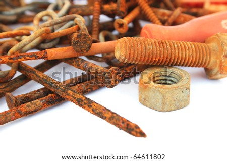 Rusty nails,nuts and bolts isolated on white background.