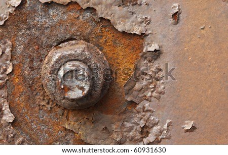 Rusty nut at the surface of steel plate closeup